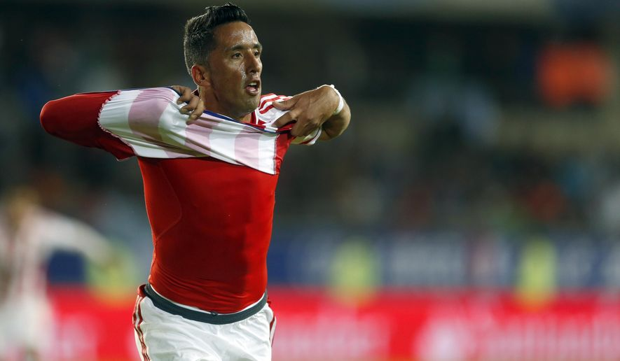 /pa8/ celebrates after scoring his team's second goal during a Copa America Group B soccer match against Argentina at La Portada stadium in La Serena, Chile, Saturday, June 13, 2015. (AP Photo/Andre Penner)