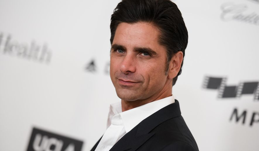 Actor John Stamos arrives at the 4th Annual Reel Stories, Real Lives Benefit in Los Angeles, April 25, 2015. (Associated Press) ** FILE **