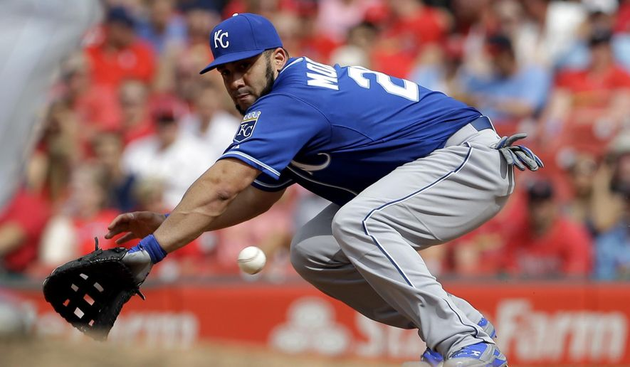 Kansas City Royals first baseman Kendrys Morales deflects but cannot stop a ball hit for a single by St. Louis Cardinals' Tyler Lyons during the fourth inning of a baseball game Saturday, June 13, 2015, in St. Louis. (AP Photo/Jeff Roberson)