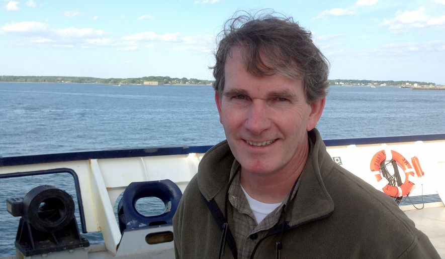 Michael Hurley, a South Carolina author who lost his storm-battered sailboat on a failed Atlantic crossing, poses for a photo on the stern of the Maine Maritime Academy training vessel Saturday, June 13, 2015, in Portland, Maine. Hurley was rescued Wednesday some 500 miles south of Newfoundland by students aboard the State of Maine, which arrived Saturday in Portland Harbor. (AP Photo/David Sharp)