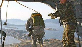 U.S. Army Paratroopers assigned 173rd Airborne Brigade train off the coast of Athens, Greece, May 26, 2015. (Image: U.S. Army, Facebook) ** FILE **