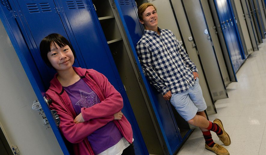 In this June 3, 2015 photo, Skyline High School seniors Juncen Wang and Hans Lehnardt pose in Salt Lake City. More Utah high school students have registered perfect scores on the ACT college entrance exam, diminishing the significance of an achievement that used to be quite rare. (Francisco Kjolseth/The Salt Lake Tribune via AP) DESERET NEWS OUT; LOCAL TELEVISION OUT; MAGS OUT