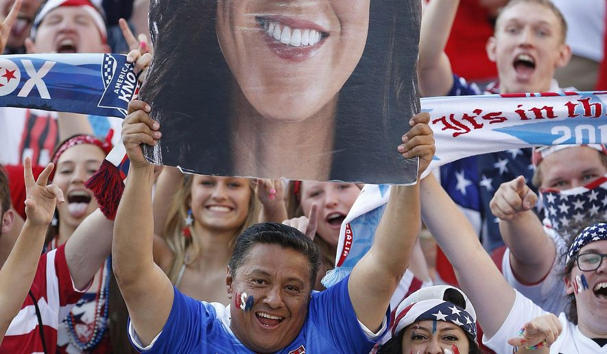United States goalkeeper Hope Solo supporters cheer prior to a match against Sweden in FIFA Women's World Cup soccer action in Winnipeg, Manitoba, Canada, Friday, June 12, 2015.(John Woods/The Canadian Press via AP) MANDATORY CREDIT