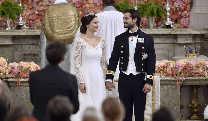 Sweden's Prince Carl Philip and Sofia Hellqvist stand at the altar during their wedding the Royal Chapel in Stockholm, Sweden, Saturday June 13, 2015.  (Claudio Bresciani/TT via AP)     SWEDEN OUT