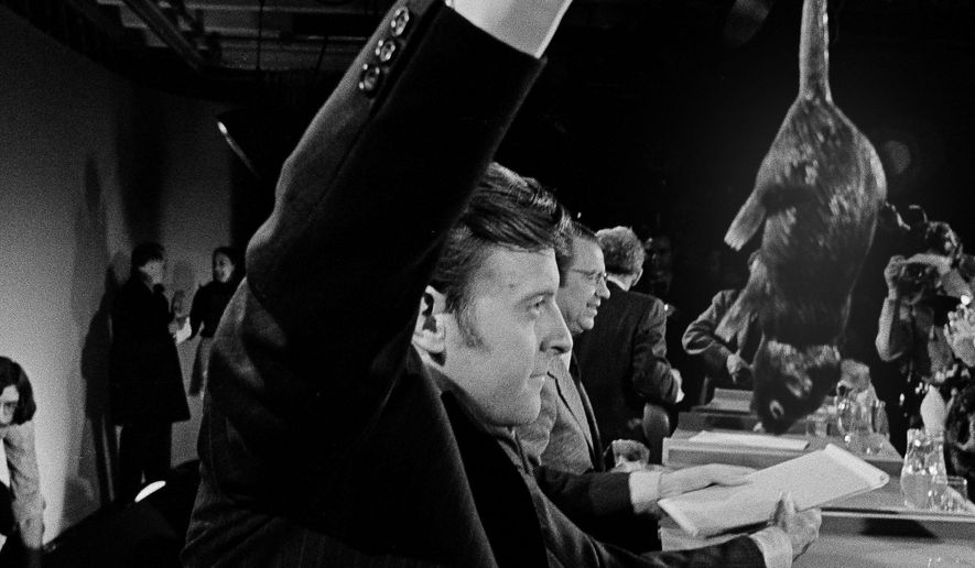FILE- In this March 6, 1972 file photo presidential candidate Edward T. Coll of Hartford, Conn., swings a rubber rat that he used during the television debate among five Democratic presidential candidates in Durham, N.H., But 75-year-old Ned Coll, who has outlived the four other Democratic candidates he faced that night,  is considering another presidential campaign. AP Photo/J. Walter Green/FILE)