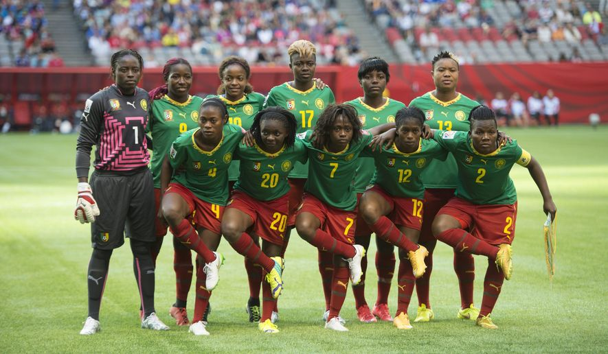 The Cameroon teams poses for a photo prior to a match against Japan at the FIFA Women's World Cup soccer tournament Friday, June 12, 2015, in Vancouver, British Columbia, Canada. (Jonathan Hayward/The Canadian Press via AP)