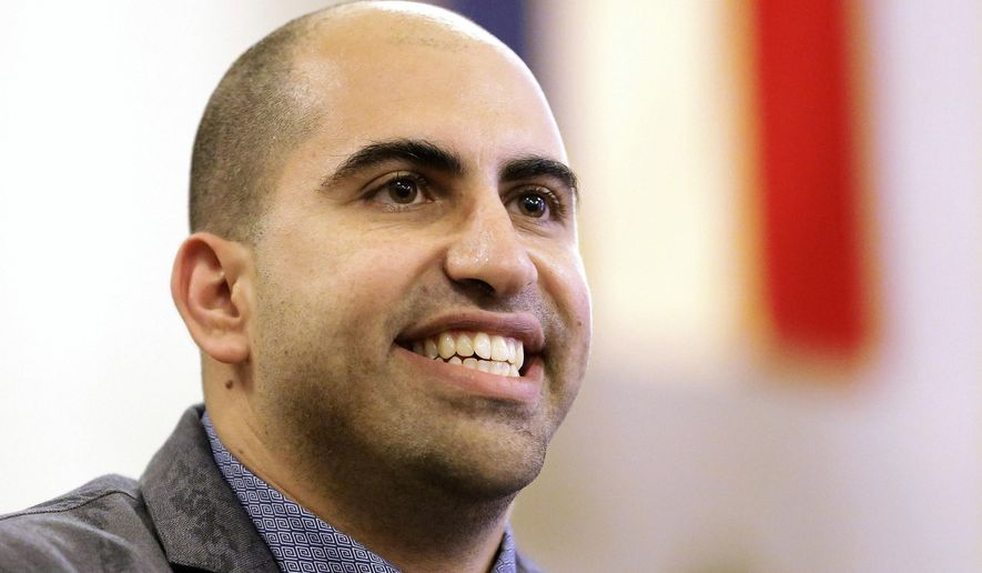 FILE - In this Sept. 9, 2014, file photo, Steve Salaita, a professor who lost a job offer from the University of Illinois over dozens of profane, anti-Israel Twitter messages, speaks during a news conference in Champaign Ill.  A leading academic group is expected to decide Saturday, June 13, 2015,  whether to censure the University of Illinois' flagship campus over its decision not to hire a Salaita following his anti-Israel Twitter messages. (AP Photo/Seth Perlman, File)