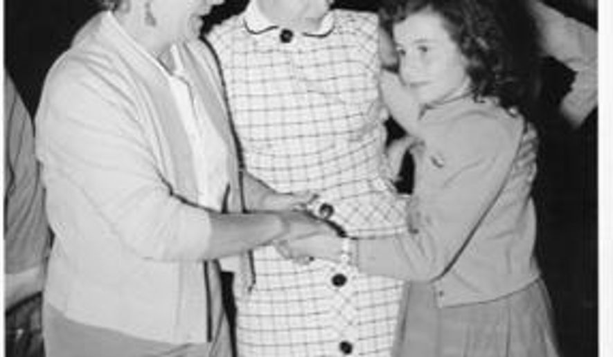 ADDS DETROIT CITY AIRPORT - This 1956 photo courtesy of Pierette Simpson shows,  from left, Grandmother, Domenica Burzio; mother, Vivian Massa and Pierette Simpson in the old Detroit City Airport. Simpson and her grandmother were dancing in the Andrea Doria's social hall, celebrating their near-arrival with other immigrants to a new life in America when the impact knocked everyone off their feet. She remembers the ship rising up and then leaning to one side. It would later sink into the Atlantic Ocean off Massachusetts. Simpson plans to tell her part of the tale in a short documentary-type production that is expected to start filming Sunday, June 14, 2015 in Ferndale, just north of Detroit. It will commemorate next year's 60th anniversary of the Andrea Doria's July 25, 1956 collision with another liner. (Photo courtesy of Pierette Simpson via AP)