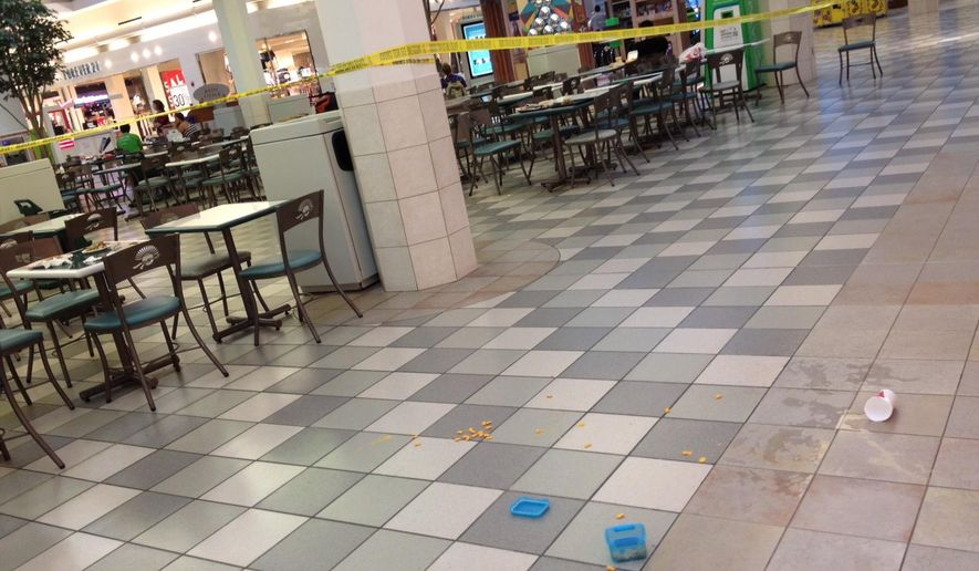 Police tape marks off a section of the food court at the Coral Ridge Mall in Coralville, Iowa, Friday, June 12, 2015. A shooting left one female dead and stunned shoppers, police said. Troopers with the Iowa State Patrol and Scott County Sheriff's deputies arrested the shooting suspect during a traffic stop on Interstate 80, about 50 miles east of the mall in Davenport, Murphy said. The suspect wasn't identified. (David Scrivner/Iowa City Press-Citizen via AP)  NO SALES