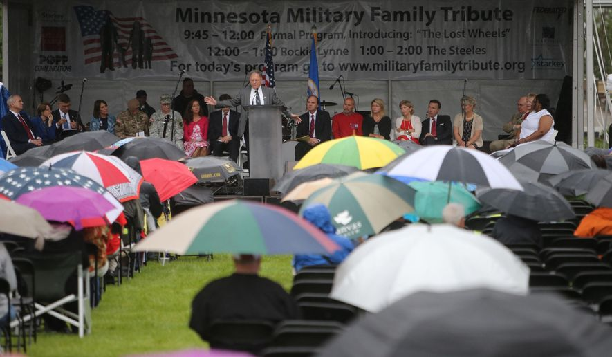 The Minnesota Military Family Tribute dedication ceremony is held Saturday, June 13, 2015, on the State Capitol Grounds in St. Paul, Minn. (David Joles/Star Tribune via AP)  MANDATORY CREDIT; ST. PAUL PIONEER PRESS OUT; MAGS OUT; TWIN CITIES LOCAL TELEVISION OUT