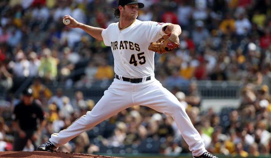 Pittsburgh Pirates starting pitcher Gerrit Cole (45) delivers in the first inning of a baseball game against the Philadelphia Phillies in Pittsburgh, Saturday, June 13, 2015. (AP Photo/Gene J. Puskar)