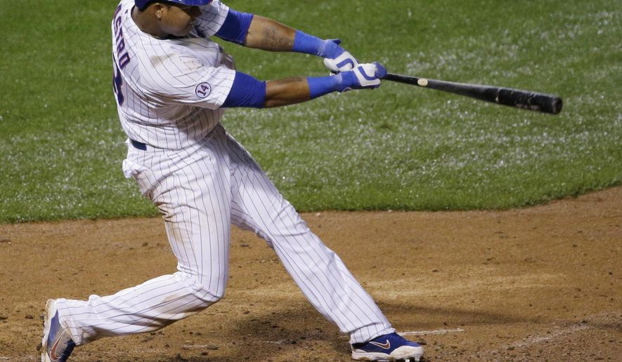 Chicago Cubs' Starlin Castro hits the game-winning single during the ninth inning of a baseball game against the Cincinnati Reds on Saturday, June 13, 2015, in Chicago. The Cubs won 4-3. (AP Photo/Nam Y. Huh)