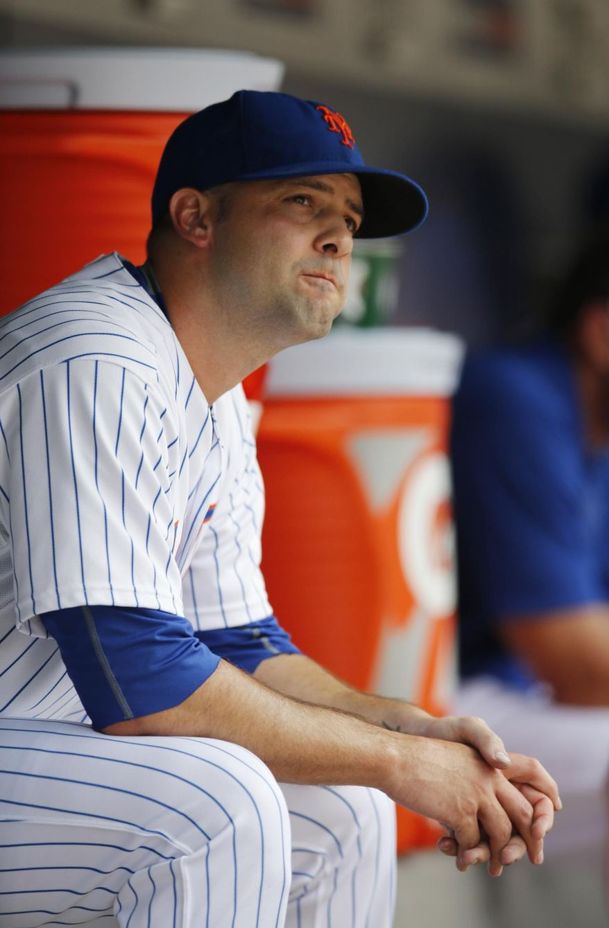 New York Mets starting pitcher Dillon Gee sits in the dugout after New York Mets manager Terry Collins (10) removed him from the game in the fourth inning of a baseball game against the Atlanta Braves in New York, Sunday, June 14, 2015. (AP Photo/Kathy Willens)