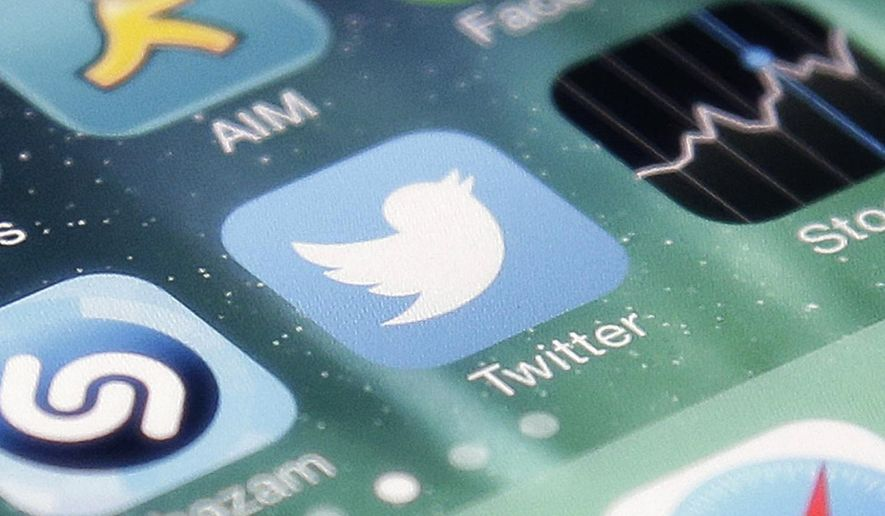 This Nov. 4, 2013 file photo shows the icon for the Twitter app on an iPhone in San Jose, Calif. (AP Photo/Marcio Jose Sanchez, File)