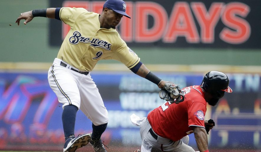 Washington Nationals' Denard Span steals second as Milwaukee Brewers' Jean Segura misses the tag during the third inning of a baseball game, Sunday, June 14, 2015, in Milwaukee. (AP Photo/Morry Gash)