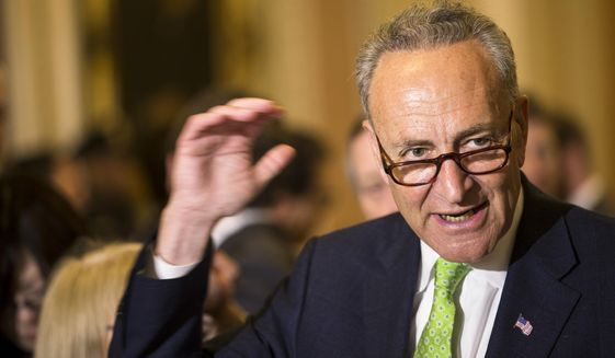 FILE - In this May 5, 2015, file photo, Sen. Charles Schumer, D-N.Y., speaks to reporters on Capitol Hill in Washington. Schumer wants airlines to scrap a proposal to reduce the allowed size of carry-on luggage. He planned a news conference Sunday, June 14, 2015, to warn travelers that a 20 percent reduction would force them to pay more for check-in fees or spend money on new luggage.  (AP Photo/Brett Carlsen, File)