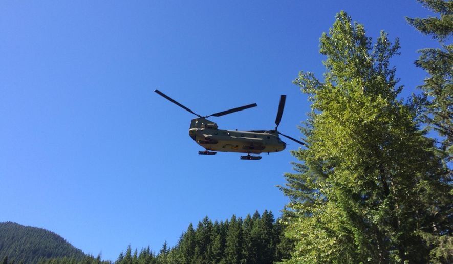 In this photo provided by the National Park Service, a U.S. Army Reserve 214th Air Division Chinook is used to search for missing Utah climber, Kyle Bufis, on Mount Rainier, Saturday, June 13, 2015, at Mount Rainier National Park, Wash. The search was called off Saturday afternoon after a helicopter spotted the body of a deceased male climber near the summit. (NPS Photo via AP) MANDATORY CREDIT