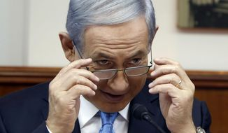 Israeli Prime Minister Benjamin Netanyahu chairs the weekly cabinet meeting at his office in Jerusalem, Sunday, June 14, 2015. (Gali Tibbon/Pool Photo via AP)