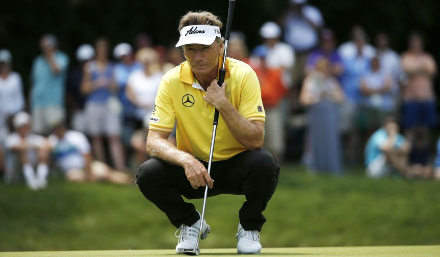 Bernhard Langer, of Germany, reads the green on the second hole during the final round of the Senior Players Championship golf tournament in Belmont, Mass., Sunday, June 14, 2015. (AP Photo/Michael Dwyer)