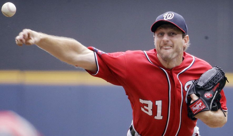 Washington Nationals starting pitcher Max Scherzer throws during the seventh inning of a baseball game against the Milwaukee Brewers Sunday, June 14, 2015, in Milwaukee. (AP Photo/Morry Gash)