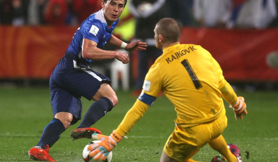 Serbia's Goalkeeper Predrag Rajkovic, left, saves a shot at goal from Rubio Rubin of the USA during their U20 soccer World Cup quarterfinal game in Auckland, New Zealand, Sunday, June 14, 2015. (AP Photo/David Rowland)