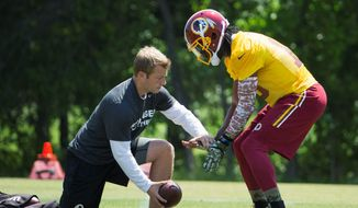 Experienced assistant coaches were brought to support Redskins offensive coordinator Sean McVay, who is just 29 years old. (Associated Press)