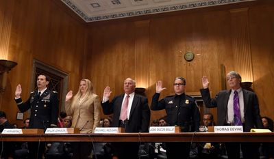 Witnesses sworn in at a Senate hearing last week were (from left) Army Lt. Col. Jason Amerine; Taylor Johnson of U.S. Immigration and Customs Enforcement; Michael Keegan, formerly of the Social Security Administration; Jose R. Ducos-Bello of U.S. Customs and Border Protection; and Thomas Devine of the Government Accountability Project. (Associated Press)