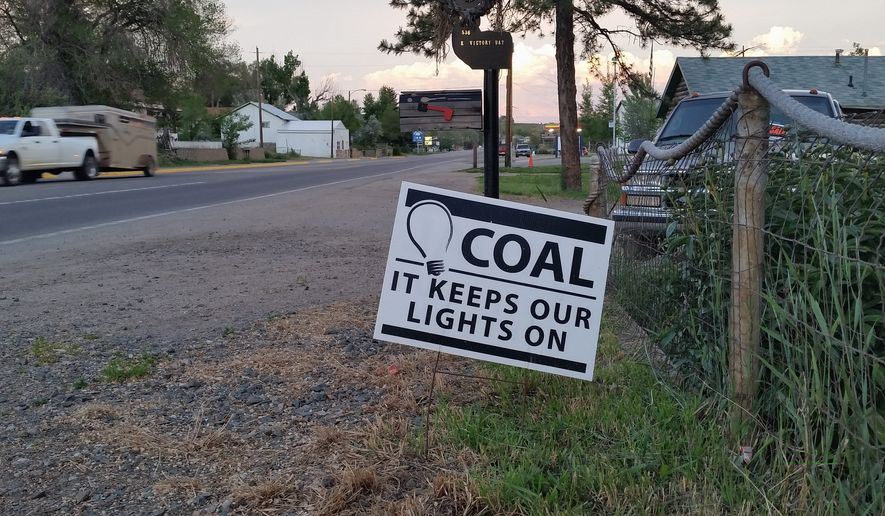 Pro-coal signs dot yards in Craig, Colorado, where residents are worried about the possible closing of the Colowyo Mine in the wake of a WildEarth Guardians lawsuit and the loss of 220 jobs. (By Valerie Richardson/The Washington Times) ** FILE **