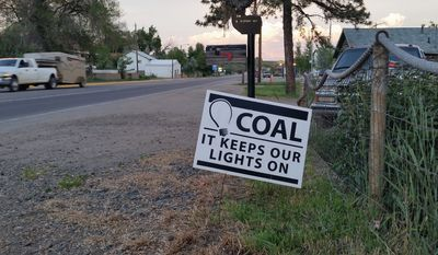 Pro-coal signs dot yards in Craig, Colorado, where residents are worried about the possible closing of the Colowyo mine in the wake of a WildEarth Guardians lawsuit and the loss of 220 jobs. (By Valerie Richardson/The Washington Times)