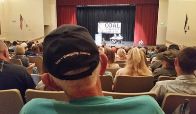 The people: Local officials take questions at a community meeting over the possible closing of the Colowyo mine at Moffat High School in Craig, Colorado. (Valerie Richardson/The Washington Times)