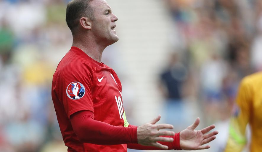 England's Wayne Rooney reacts during the Euro 2016 Group E qualifying soccer match between Slovenia and England, in Ljubljana, Slovenia, Sunday, June 14, 2015. (AP Photo/Darko Bandic)