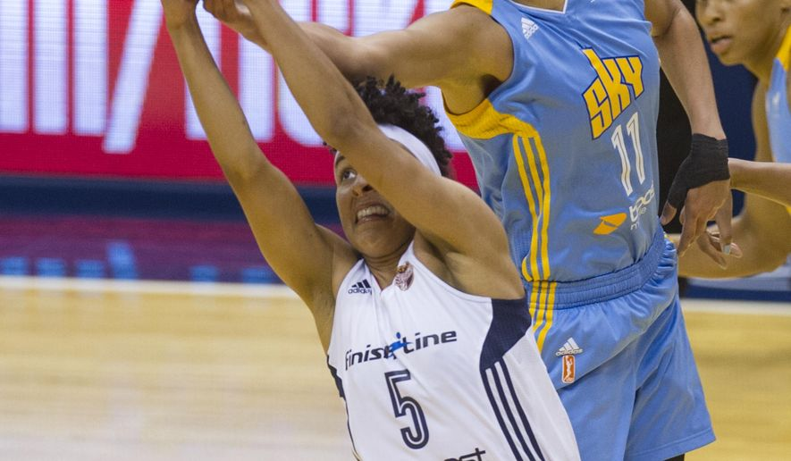 Chicago Sky forward Elena Delle Donne (11) goes over the top of Indiana Fever guard Layshia Clarendon (5) for a long rebound during the first half of an WNBA basketball game, Sunday, June 14, 2015, in Indianapolis. (AP Photo/Doug McSchooler)