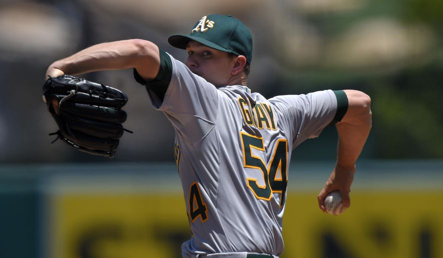 Oakland Athletics starting pitcher Sonny Gray throws to the plate during the first inning of a baseball game against the Los Angeles Angels, Sunday, June 14, 2015, in Anaheim, Calif. (AP Photo/Mark J. Terrill)