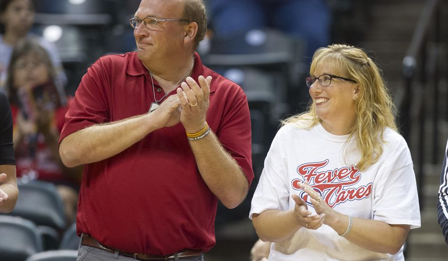 Brent and Lisa Hill, parents of the late Lauren Hill, are recognized during pre-game activities before the WNBA basketball game between the Chicago Sky and the Indiana Fever, Sunday, June 14, 2015, in Indianapolis. Lauren Hill was proclaimed an honorary member of the Indiana Fever. (AP Photo/Doug McSchooler)