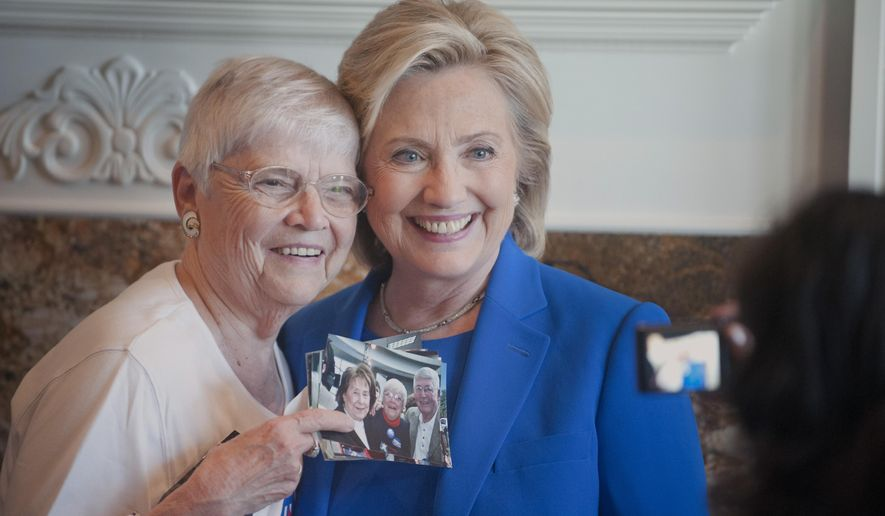 Anita Wendt, of Sioux City, Iowa poses for a photo with Democratic presidential hopeful, former Secretary of State Hillary Rodham Clinton, during a campaign house party Saturday, June 13, 2015, in Sioux City, Iowa. (Justin Wan/The Sioux City Journal via AP)