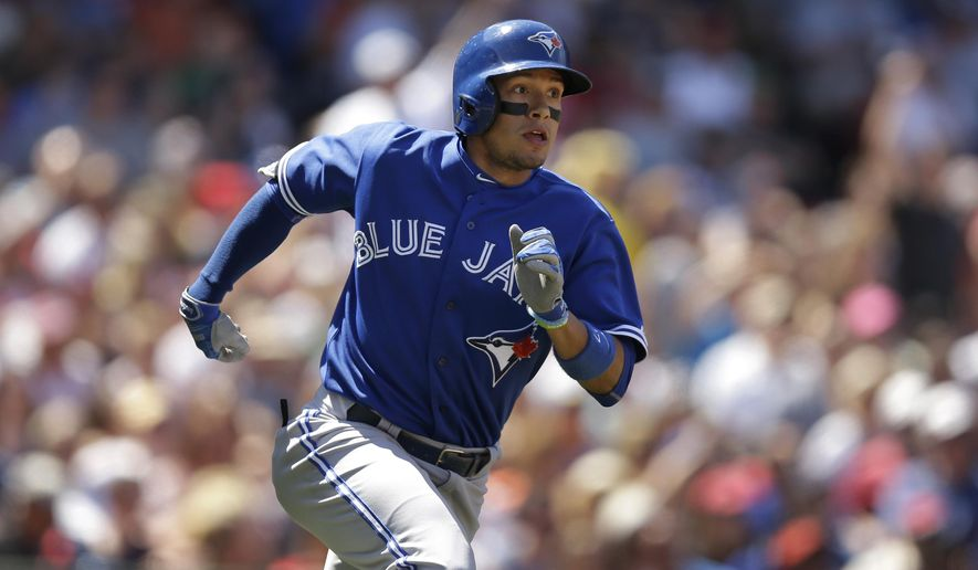 Toronto Blue Jays' Ryan Goins runs the bases after hitting a three-run home run off a pitch by Boston Red Sox's Eduardo Rodriguez in the fourth inning of a baseball game at Fenway Park, Sunday, June 14, 2015, in Boston. (AP Photo/Steven Senne)