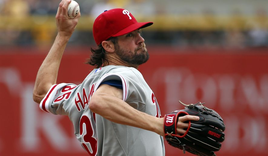 Philadelphia Phillies starting pitcher Cole Hamels delivers in the first inning of a baseball game against the Pittsburgh Pirates in Pittsburgh, Sunday, June 14, 2015. (AP Photo/Gene J. Puskar)