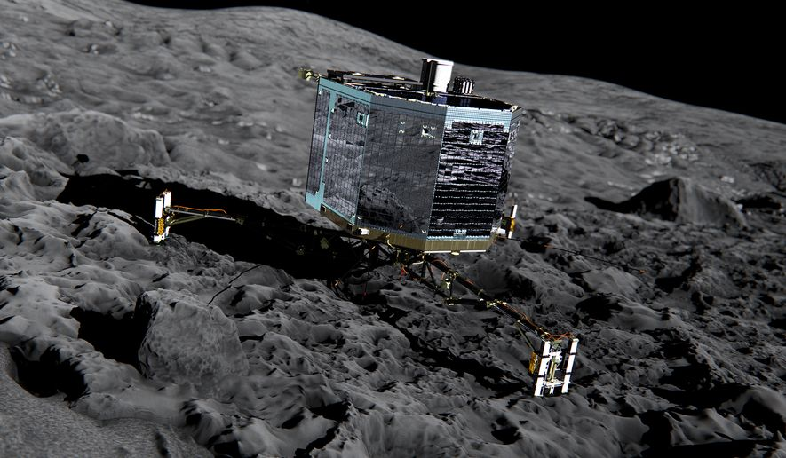 This artist impression from December 2013 by ESA/ATG medialab, publicly provided by the European Space Agency, ESA, shows Rosetta's lander Philae (front view) on the surface of comet 67P/Churyumov-Gerasimenko. The comet lander Philae has awakened from a seven-month hibernation and managed to communicate with Earth for more than a minute, the European Space Agency said Sunday, June 14, 2015. The probe became the first spacecraft to land on a comet when it touched down on the icy surface of 67P/Churyumov-Gerasimenko in November. (ESA/ATG medialab/ESA  via AP)