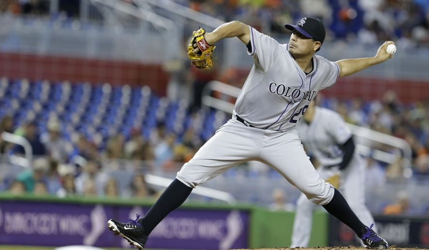 Colorado Rockies' Jorge De La Rosa delivers a pitch during the first inning of a baseball game against the Miami Marlins, Sunday, June 14, 2015, in Miami. (AP Photo/Wilfredo Lee)