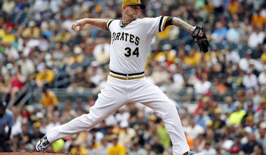 Pittsburgh Pirates starting pitcher A.J. Burnett (34) delivers in the first inning of a baseball game against the Philadelphia Phillies in Pittsburgh, Sunday, June 14, 2015. (AP Photo/Gene J. Puskar)