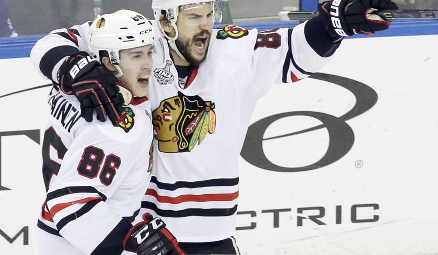Chicago Blackhawks center Antoine Vermette (80) celebrates with left wing Teuvo Teravainen (86) after scoring a goal against the Tampa Bay Lightning during the third period of Game 5 of the NHL hockey Stanley Cup Final, Saturday, June 13, 2015, in Tampa, Fla. (AP Photo/John Raoux)