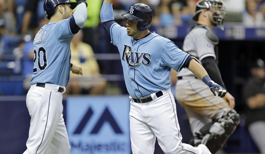 Tampa Bay Rays' Asdrubal Cabrera, front right, high-fives teammate Steven Souza Jr., left, after hitting a two-run home run off Chicago White Sox starting pitcher Chris Sale during the seventh inning of a baseball game Sunday, June 14, 2015, in St. Petersburg, Fla.  (AP Photo/Chris O'Meara)