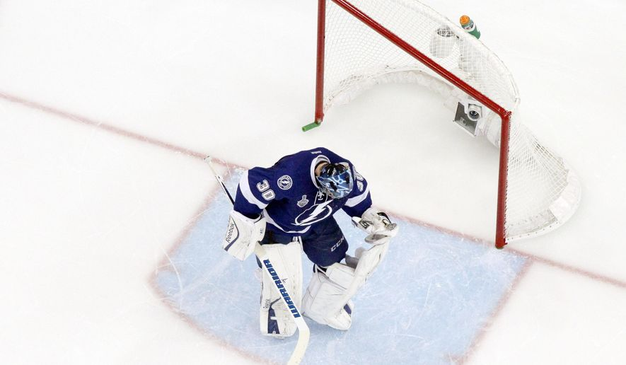 Tampa Bay Lightning goalie Ben Bishop (30) adjusts his knee pad after the Chicago Blackhawks scored a goal during the third period of Game 5 of the NHL hockey Stanley Cup Final, Saturday, June 13, 2015, in Tampa, Fla. The Blackhawks won 2-1. (AP Photo/John Raoux)