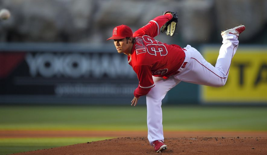 Los Angeles Angels starting pitcher C.J. Wilson throws to the plate during the first inning of a baseball game against the Oakland Athletics, Saturday, June 13, 2015, in Anaheim, Calif. (AP Photo/Mark J. Terrill)