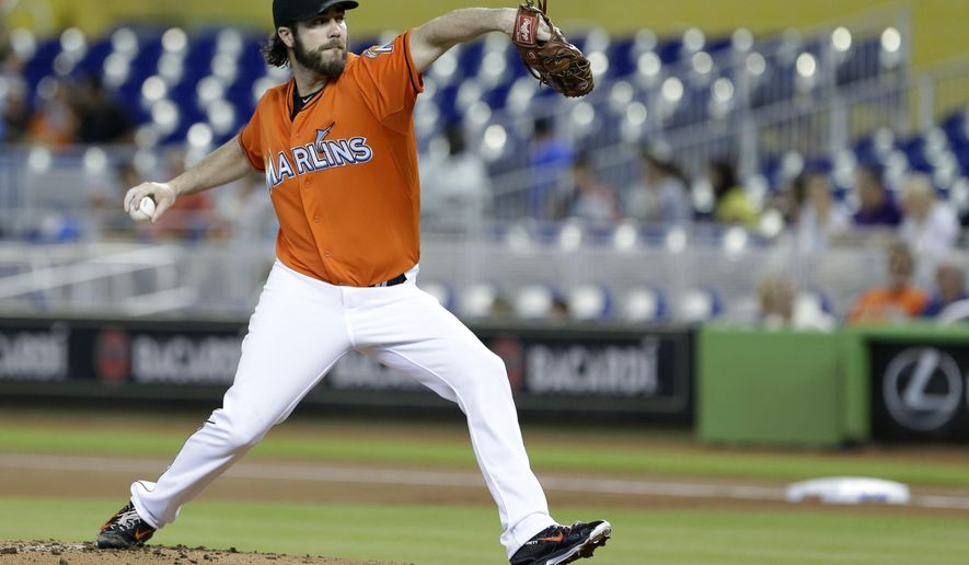 Miami Marlins' Dan Haren delivers a pitch during the first inning of a baseball game against the Colorado Rockies, Sunday, June 14, 2015, in Miami. (AP Photo/Wilfredo Lee)