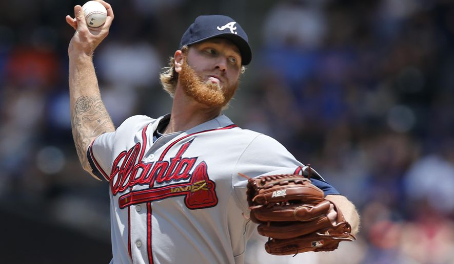 Atlanta Braves starting pitcher Michael Foltynewicz delivers in the first inning of a baseball game against the New York Mets in New York, Sunday, June 14, 2015. (AP Photo/Kathy Willens)