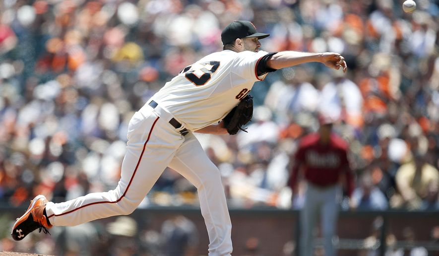 San Francisco Giants pitcher Chris Heston works against the Arizona Diamondbacks in the first inning of a baseball game Sunday, June 14, 2015, in San Francisco. (AP Photo/Tony Avelar)