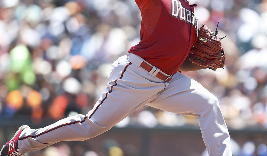Arizona Diamondbacks pitcher Rubby De La Rosa (12) works against the San Francisco Giants in the first inning of a baseball game Sunday, June 14, 2015, in San Francisco. (AP Photo/Tony Avelar)
