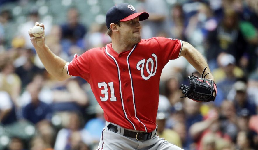 Washington Nationals starting pitcher Max Scherzer throws during the first inning of a baseball game against the Milwaukee Brewers, Sunday, June 14, 2015, in Milwaukee. (AP Photo/Morry Gash)