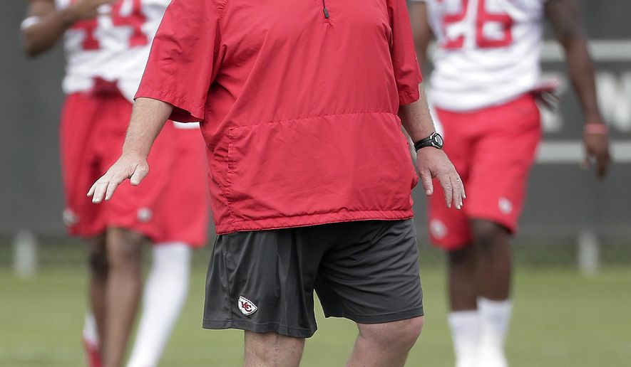 Kansas City Chiefs coach Andy Reid watches a drill during an NFL football organized team activity, Thursday, June 11, 2015, in Kansas City, Mo. (AP Photo/Charlie Riedel)